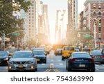traffic along 3rd avenue in... | Shutterstock . vector #754363990