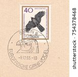 Small photo of GERMANY-CIRCA 1965:A stamp printed in Germany,shows Northern Goshawk (Accipiter gentilis)-bird of prey of the family accipitridae.Special postmark Berlin,European birds of prey,circa 1965