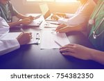 medical team having a meeting... | Shutterstock . vector #754382350