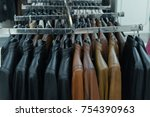 rows of black and brown leather ... | Shutterstock . vector #754390963