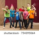 children at acting camp pose... | Shutterstock . vector #754395064