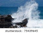 ocean wave with lava rocks ...   Shutterstock . vector #75439645