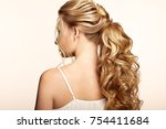 blonde girl with long and shiny ... | Shutterstock . vector #754411684