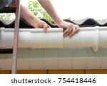 contractor installing plastic... | Shutterstock . vector #754418446