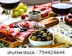variety food on table  wine... | Shutterstock . vector #754424644