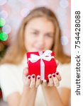 teen girl giving a christmas... | Shutterstock . vector #754428088