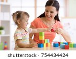 cute woman and child girl... | Shutterstock . vector #754434424