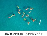 large group of kayaks at calm...   Shutterstock . vector #754438474