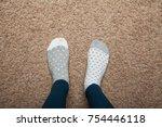 the girl is on the floor in... | Shutterstock . vector #754446118