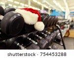 santa's hat in the gym.    Shutterstock . vector #754453288