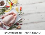 cooking raw chicken with herbs... | Shutterstock . vector #754458640