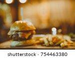 blur of big tasty burger and... | Shutterstock . vector #754463380
