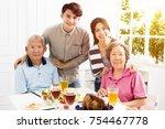 happy family having dinner... | Shutterstock . vector #754467778