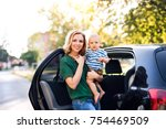 young mother holding her little ... | Shutterstock . vector #754469509
