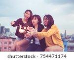 happy group of asia girl... | Shutterstock . vector #754471174