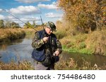 fisherman with a big pike | Shutterstock . vector #754486480