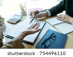 business man and lawyer looking ... | Shutterstock . vector #754496110