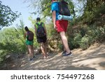 hiker travels in the forest...   Shutterstock . vector #754497268