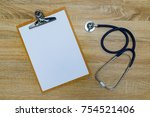 stethoscope and clipboard with... | Shutterstock . vector #754521406