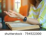 woman praying on holy bible in... | Shutterstock . vector #754522300