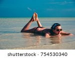 young woman lying in water.... | Shutterstock . vector #754530340
