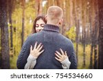 a beautiful girl hugs her... | Shutterstock . vector #754534660