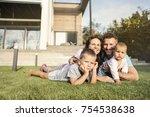 happy family in the garden | Shutterstock . vector #754538638
