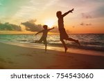 father and little son enjoy... | Shutterstock . vector #754543060