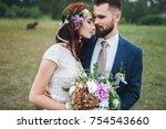 the bride and groom tenderly... | Shutterstock . vector #754543660