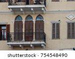 balconies of old european houses | Shutterstock . vector #754548490