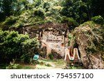 Small photo of Old torajan burial site in Lemo, Tana Toraja. The cemetery with coffins placed in caves carved into the rock and balconies with dressed wooden statues tau tau. Rantapao, Sulawesi, Indonesia