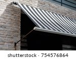 Small photo of black and white awning over a window