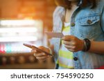 woman use smart phone and...   Shutterstock . vector #754590250