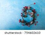 mistletoe wreath on blue... | Shutterstock . vector #754602610