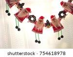 santa claus hanging by window   Shutterstock . vector #754618978