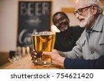 close up shot of senior friends ... | Shutterstock . vector #754621420