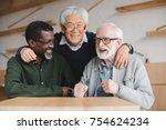 group of multiethnic senior... | Shutterstock . vector #754624234