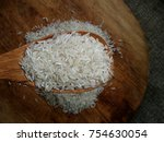 heap of jasmine raw rice in... | Shutterstock . vector #754630054