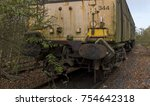 abandoned rusty locomotive | Shutterstock . vector #754642318