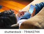 woman consulting weather... | Shutterstock . vector #754642744