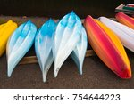 colorful kayaks in row   Shutterstock . vector #754644223