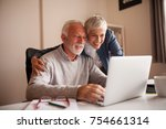 mature couple browsing the... | Shutterstock . vector #754661314