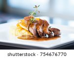roasted duck with mashed... | Shutterstock . vector #754676770