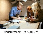 team working on project together | Shutterstock . vector #754681024