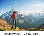 woman hiker standing on the top ... | Shutterstock . vector #754684348
