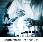 Small photo of scientist with equipment and science experiments,science background.