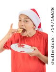 Teenage boy about to eat a mince pie - stock photo