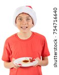 Teenage boy with a jam tart - stock photo