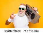 Stock photo cheerful excited aged funny active sexy athlete cool pensioner grandpa in eyewear with bass 754741603