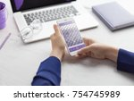 man holding phone in hand.... | Shutterstock . vector #754745989